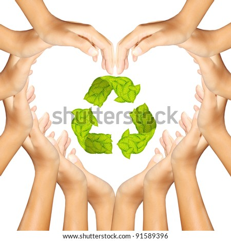 Recycle Logo in hands making a heart - stock photo