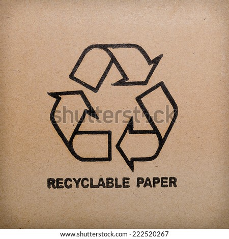 recycle logo on recycled paper background - stock photo