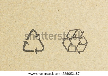 recycle logo on recycled paper background. - stock photo