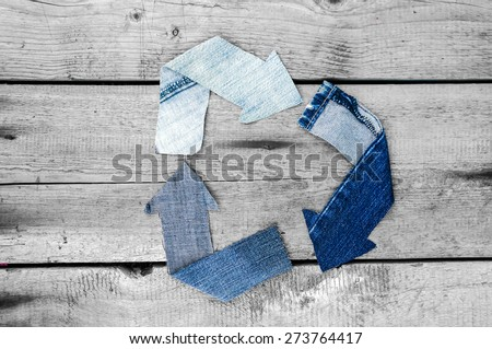 Recycle logo over grunge grey wooden background - stock photo