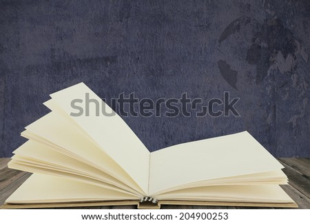 Recycle notebook on wood floor with grunge background - stock photo