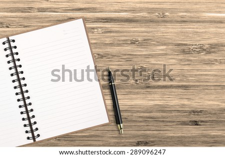 recycle notebook with pen on chic table for your design - stock photo
