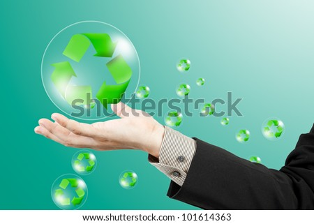 Recycle sign on business hand - stock photo