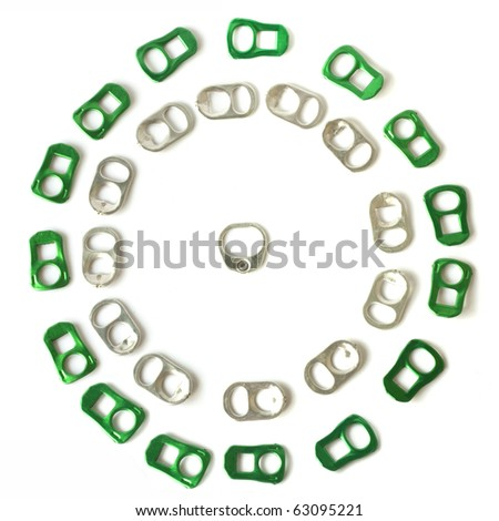 recycle theme from soda tab and pull ring from soft drink can - stock photo