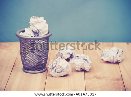 Recycle,trash bin and crumpled paper balls on wood ; vintage tone style - stock photo
