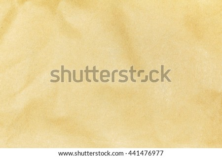 Recycled crumpled brown paper texture background for design with copy space for text or image. - stock photo