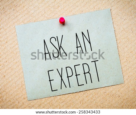 Recycled paper note pinned on cork board.Ask an Expert Message. Concept Image - stock photo