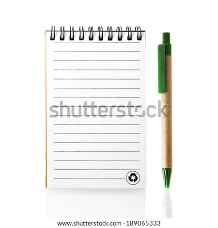 Recycled paper notebook with Recycle logo and pen. - stock photo