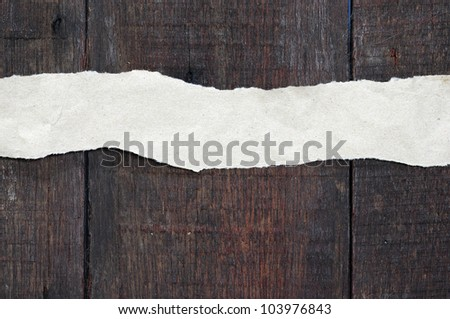 recycled paper ripped on real wood background - stock photo