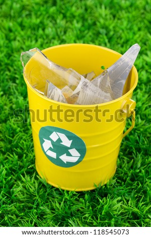 Recycling bin on green grass - stock photo