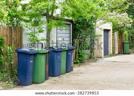 Recycling bins in a row on a street in Cambridge - stock photo