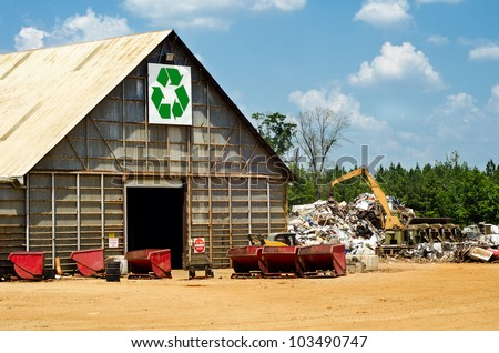 Recycling center with scrap yard and heavy machinery - stock photo