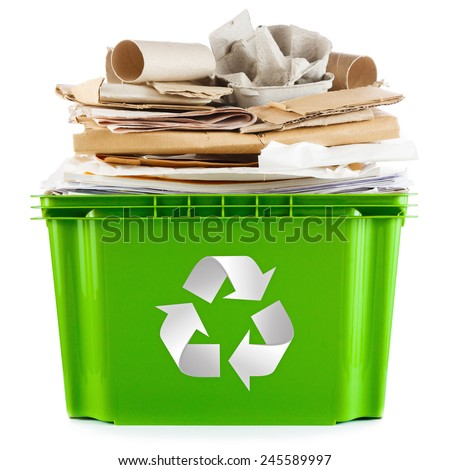 Recycling concept - bin full of old newspapers, paper, cardboard and egg boxes - stock photo