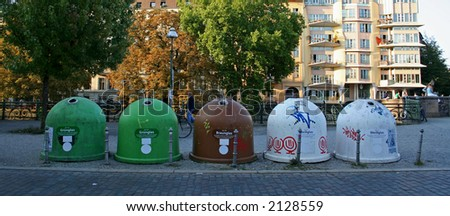 recycling containers lined up on a street in berlin, germany - stock photo