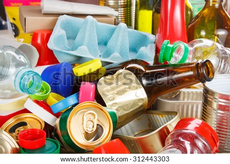 Recycling garbage and reusable waste management as metal, plastic, old paper products to be reused - stock photo