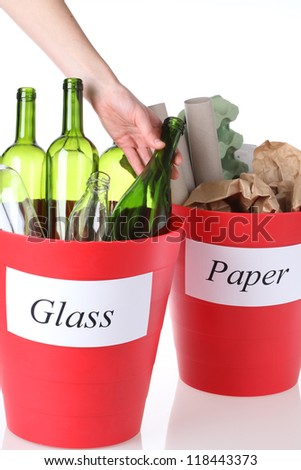 Recycling: glass and paper bins ready to recycle - stock photo
