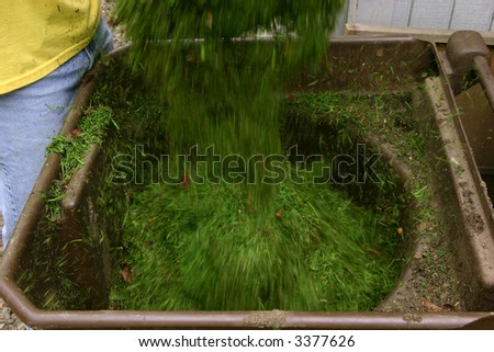 Recycling grass clippings - stock photo