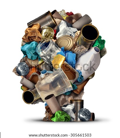 Recycling ideas and environmental garbage management solutions and creative ways to reuse waste as old paper glass metal and plastic bottles shaped as a human head as a symbol for reusable thinking. - stock photo