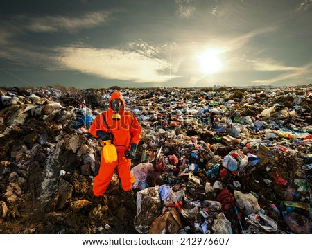 Recycling worker standing on the landfill - stock photo