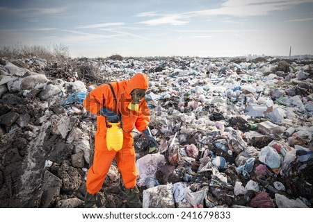 Recycling worker working on the landfill - stock photo