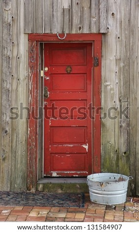 Red aged door way - stock photo