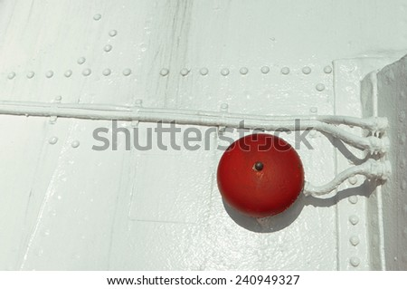 red alarm bell on white boat hull - stock photo