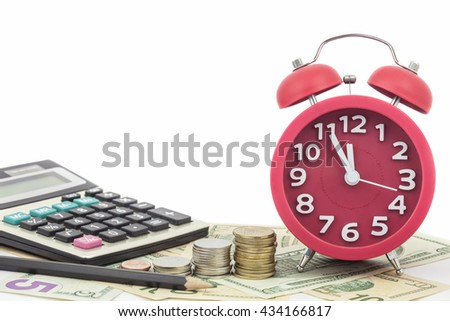 Red alarm clock and Calculator on money banknotes Euro and Dollars,concept of business planning and finance and savings deadline - stock photo