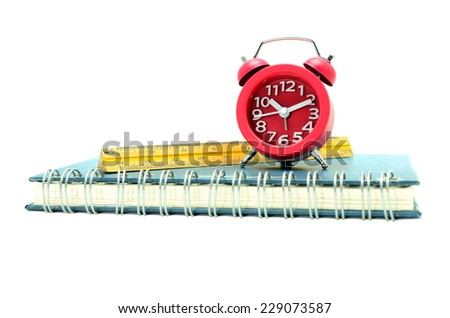 red alarm clock isolated on white - stock photo
