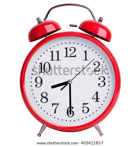 Red alarm clock shows half of the ninth - stock photo