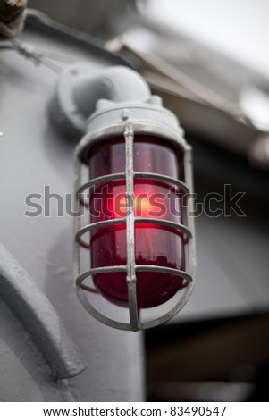 Red Alert light in protective cage - stock photo