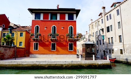 red ancient house building in old town city Venice, Italy - stock photo