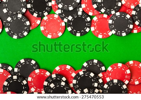 Red and black gambling chips. vintage background - stock photo