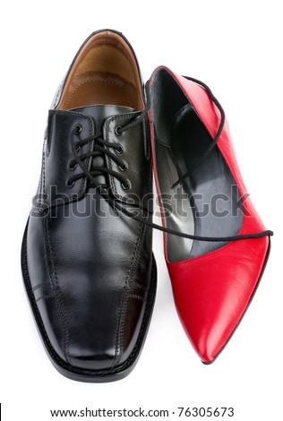 Red and black shoes isolated on white - stock photo