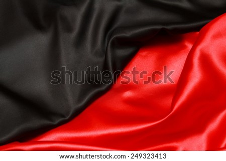 Red and black silk. top view - stock photo
