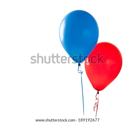 Red and blue balloons on a white background with copy space - stock photo