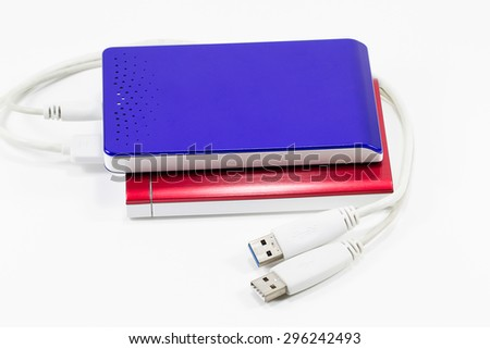 Red and blue external hard disk isolated on white background  - stock photo