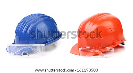 Red and blue hard hat with glasses. Isolated on a white background. - stock photo