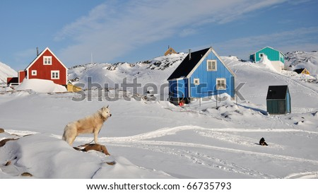 Red and blue house in the Kulusuk village, Greenland - stock photo