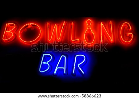 Red and blue neon sign of the words 'Bowling bar' on a black background. - stock photo