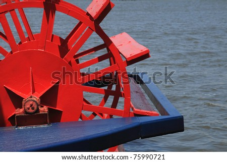 Red and blue riverboat paddle-wheel - stock photo