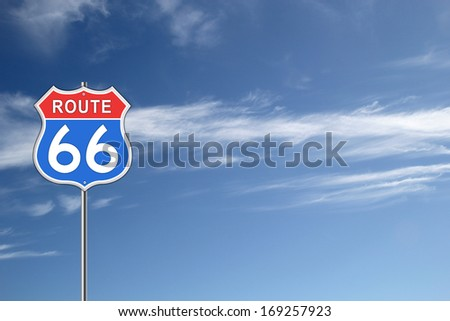 Red and blue Route 66 Road Sign isolated on blue sky background. - stock photo