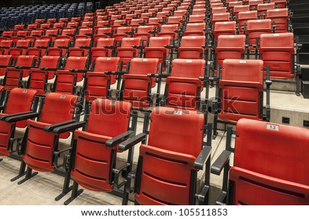 red and cinema or theater empty seats in auditorium - stock photo