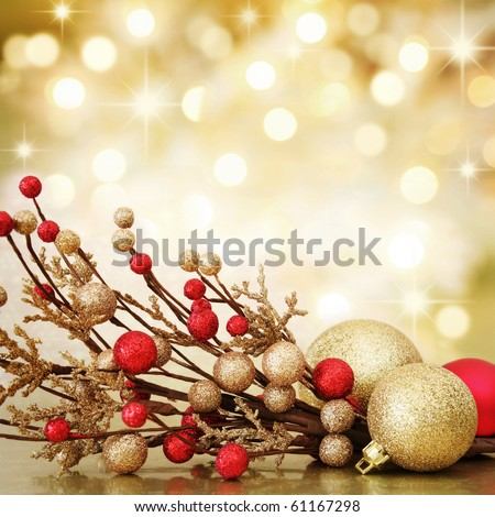 Red and gold Christmas baubles on background of defocused golden lights. Shallow DOF. - stock photo