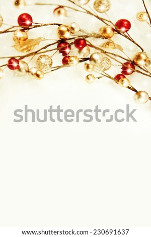 Red and gold Christmas baubles on snow. - stock photo