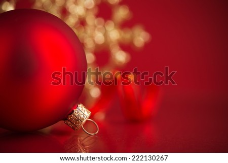 Red and golden christmas ornaments on red background with copy space. Xmas holiday theme. - stock photo