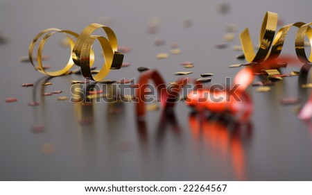 red and golden spirals, small confetti stars, party time - stock photo