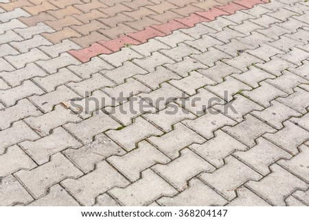 Red and gray brick paving stones on a sidewalk. - stock photo