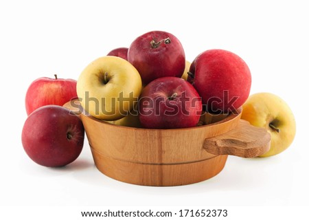 red and green apples in a basket - stock photo