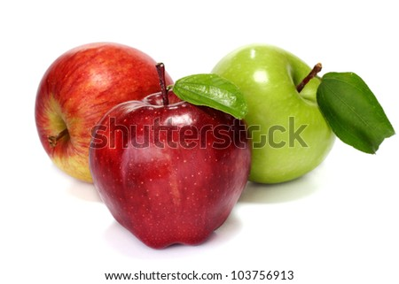 Red and green apples on white - stock photo