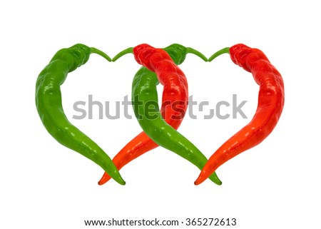 Red and green chili peppers in love. Hearts composed of hot peppers. Isolated on white background. - stock photo